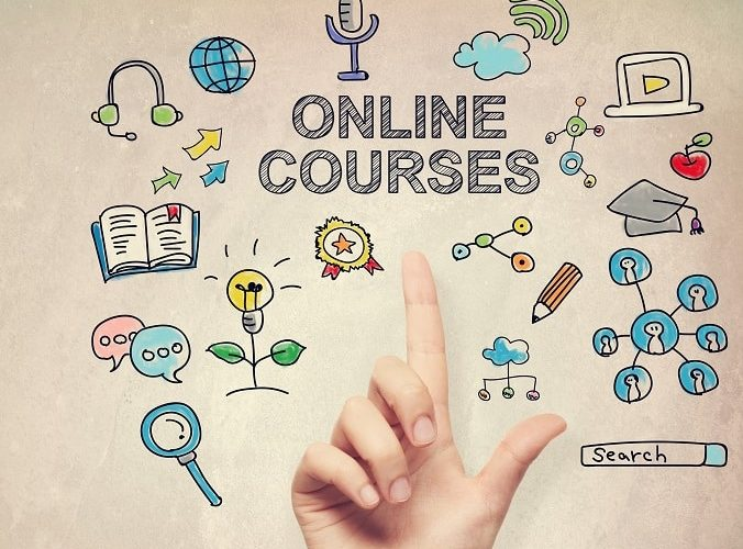 Hand pointing to online course concept on light brown wall background